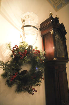 Wreath hung on wall sconce
