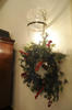 wreath hanging on light sconce