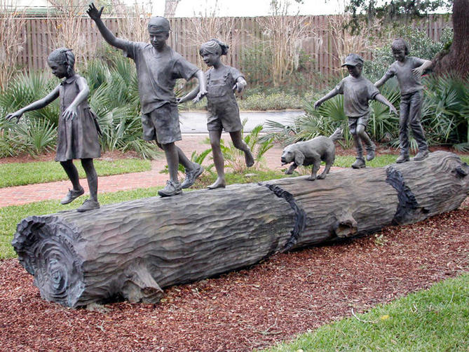 Children Playing on Log Sculpture
